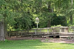 Peaceful Park. A peaceful park with a walkway and bird feeder Stock Images