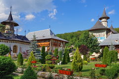Spring landscape. Orthodox church - Monastery Bujoreni, landmark attraction in Romania. Orthodox church. The Garden of the Monastery Bujoreni - landmark Royalty Free Stock Photography