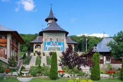 Orthodox church - Monastery Bujoreni, landmark attraction in Romania. Spring landscape Stock Photo