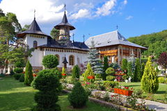Orthodox church - Monastery Bujoreni, landmark attraction in Romania. Spring landscape Royalty Free Stock Photo