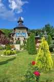 Spring landscape. Orthodox church - Monastery Bujoreni - landmark attraction in Vaslui County, Romania. Orthodox church. The Garden of Monastery Bujoreni royalty free stock images