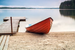 Peaceful place, lake, boat and jetty Stock Photo