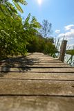 Peaceful place at the pond. Jetty and Peaceful place at the pond Stock Photos