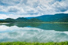 Peaceful pond near mountain in the morning in nature in Thailand. Peaceful pond near mountain in the morning in nature in Thailand Royalty Free Stock Images