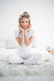 Peaceful pretty blonde wearing hair curlers posing Stock Image
