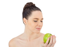 Peaceful pretty model holding apple stock images