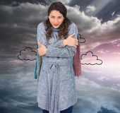 Peaceful pretty model with winter clothes being cold Royalty Free Stock Photos
