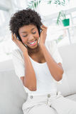Peaceful pretty woman listening to music Royalty Free Stock Photos
