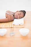 Peaceful pretty woman lying a bamboo mat Royalty Free Stock Image