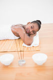 Peaceful pretty woman lying a bamboo mat Royalty Free Stock Photography