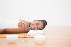 Peaceful pretty woman lying a bamboo mat Stock Images