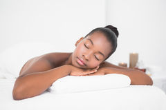 Peaceful pretty woman lying on massage table Stock Image