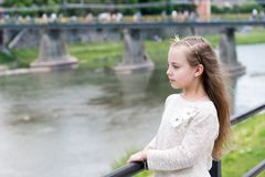 Peaceful princess. Girl princess with little crown river background copy space. Princess girl with long hair in white royalty free stock image