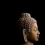 Peaceful profile of Buddha sculpture Royalty Free Stock Images