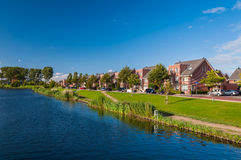 Peaceful quiet suburban with expensive houses on lake in Europe Stock Images