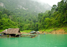 Peaceful. Raft houses with mountain behind Royalty Free Stock Images