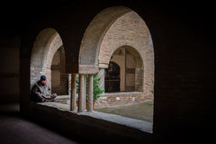 Peaceful reading in old monastery Royalty Free Stock Image