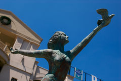 Peaceful Release. A public staute in Hot Springs Arkansas of a lady releasing a dove Stock Photo