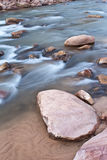 Peaceful river. Riverbed with red rocks and soft flowing water in Zion's National Park Royalty Free Stock Image