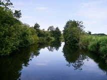 Peaceful river scene with riverbanks Royalty Free Stock Photography