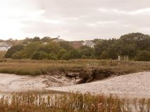 Peaceful riverbed coast scene with tide out and low, across the Stock Images