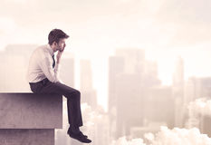 Peaceful sales guy sitting on roof top Royalty Free Stock Images