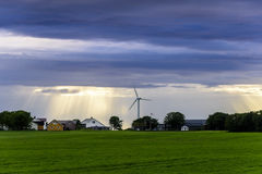 Peaceful Scandinavian Village. With blue skies and bright sunset with wind mill Stock Images