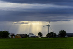 Peaceful Scandinavian Village. With blue skies and bright sunset with wind mill Royalty Free Stock Photography