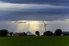 Peaceful Scandinavian Village. With blue skies and bright sunset with wind mill Stock Photos