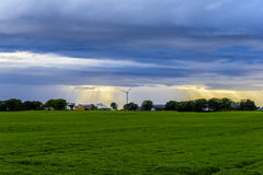Peaceful Scandinavian Village. With blue skies and bright sunset with wind mill Stock Photography