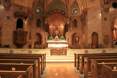 Peaceful scene with empty pews in front of alter, Holy Ghost Catholic Church,downtown Denver,2015 Royalty Free Stock Photography