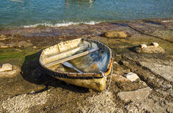 Peaceful scene with a fishing boat in Capri Island Stock Photography