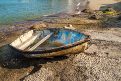 Peaceful scene with a fishing boat in Capri Island Royalty Free Stock Photo