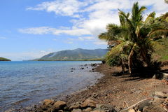 Peaceful scene of shoreline in tropical setting Stock Photo