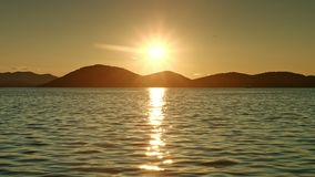 Sun shining above sea. Sunset stock footage
