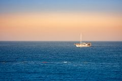 Peaceful sea landscape with a boat in the evening colours. On wonderful weather, horizontal picture stock images