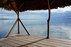 Peaceful seascape from tropical hut over the water stock photos