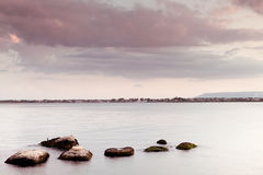 Peaceful seascape - water sky and rocks Stock Photo