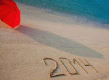 Peaceful seashore with 2014 drawn on  sand Royalty Free Stock Photo