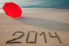 Peaceful seashore with 2014 drawn on  sand Stock Image