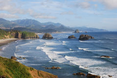 Peaceful setting. Cannon Beach with Haystack Rock in the Distance Royalty Free Stock Photography