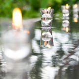 Peaceful Setting Candle on Water Stock Photos