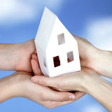 Peaceful sky and our house in our hands Stock Photography