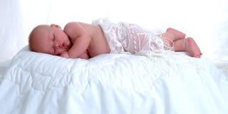 Peaceful Sleep. A reclining baby sleeps peacefully Stock Photography