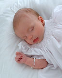 Peaceful Sleep. Beautiful baby girl on white background sleeping peacefully Stock Image