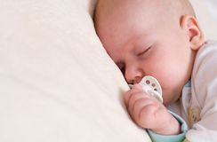 Peaceful sleeping beautiful baby Stock Photo