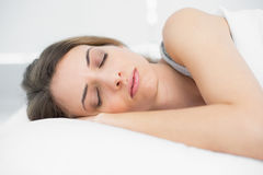Peaceful sleeping woman lying on her bed Royalty Free Stock Photo
