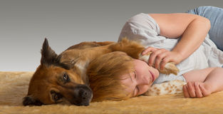 Peaceful slumber with gentle dog Stock Photography