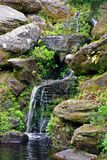 Peaceful small rock waterfall Stock Images