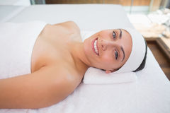 Peaceful smiing brunette lying on massage table Royalty Free Stock Photo